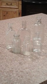 6 old clear bottles with cork tops in Fort Polk, Louisiana