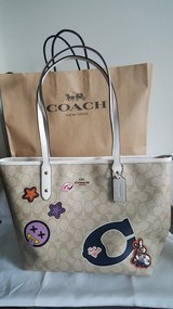 Nwt Coach city zip Varsity with patch in 29 Palms, California