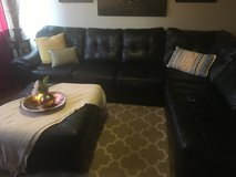 Brown sectional couch and ottoman in San Clemente, California