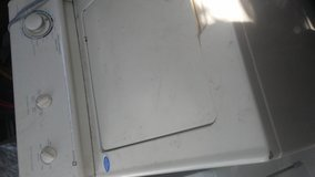 Maytag Top load washing machine and Metal door front load dryer in Lawton, Oklahoma