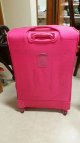 pink checked in bag  / luggage in Okinawa, Japan