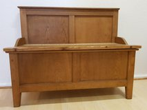 Antique wooden bench with storage compartment in Ramstein, Germany