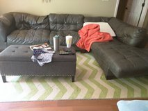 Curb alert couch and area rug in Fort Campbell, Kentucky