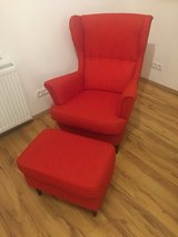 IKEA Strandmon Wing Chair with Ottoman in Ramstein, Germany
