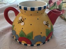 Yellow, red, blue, and white bee and flower decorative teapot in Yucca Valley, California