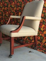 Chair Beige Fabric with Wood Trim Arm Rests and Wood Legs with rollers in Bellaire, Texas