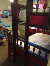 Custom made solid wood bunk beds, bed side tables, and painted to match dresser in Houston, Texas