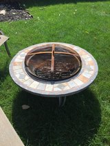 Stone & wrought iron fire pit in Bolingbrook, Illinois