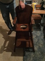 Antique high chair/potty/activity desk. Solid wood. Transitions smoothly. in Elizabethtown, Kentucky