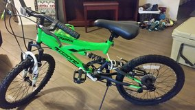 """Ozone 500 Boys 7S Ultra Shock Mountain Bicycle-Green 20"" in Kingwood, Texas"