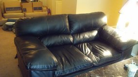 Leather couch and love seat set in Clarksville, Tennessee