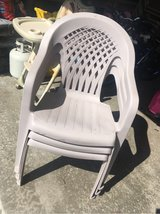 Three Plastic Patio Chairs in Joliet, Illinois