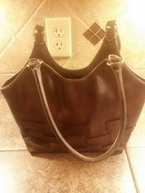 Brown leather purse in Baytown, Texas