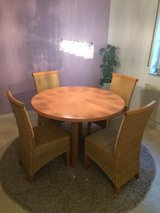 Table with 4 rattan chairs in Ramstein, Germany