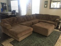 Sectional couch and Ottoman in Oswego, New York