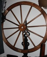 Large wooden wagon wheel decor in Fort Knox, Kentucky