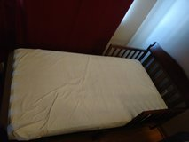 Toddler bed w plastic covered mattress in Oswego, Illinois