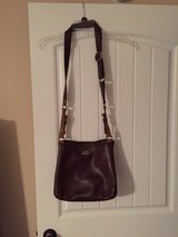 Fossil leather cross body purse in Fort Campbell, Kentucky