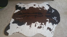 Cow print area rug in Fort Bragg, North Carolina