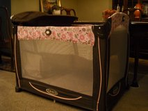pink pack and play by Graco  with changing table and built in shelf for diapers and supplies in Naperville, Illinois