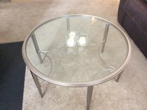 Round glass coffee table with two matching side tables in Fairfax, Virginia