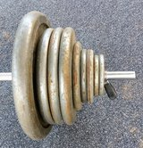 300 lbs iron free weights + bar. in Alamogordo, New Mexico
