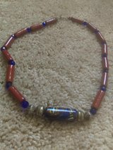 Beautiful beaded necklace in dark blue and red brick in Luke AFB, Arizona