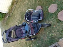 Baby trend expedition Jogger Stroller and car seat with  base in Batavia, Illinois