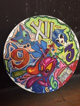 hand painted clock on a vinyl record that works in Ruidoso, New Mexico