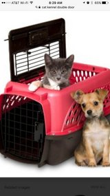 in need of small double door kennel that fits up to 20-25 lbs animals in Leesville, Louisiana