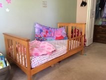 Wood toddler bed with mattress in Naperville, Illinois
