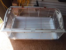Rabbit cage with supplies in Lawton, Oklahoma