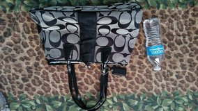 Black and gray coach purse in Fort Bliss, Texas