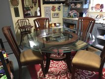 "Glass top wood base table 5 ft wide 4 chairs 42"" high in Conroe, Texas"