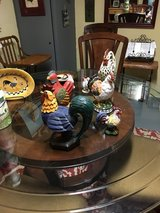 Collection of roosters and chickens and wall hangings in Conroe, Texas
