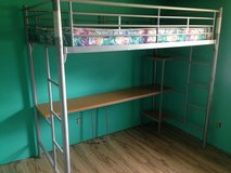 Twin metal loft bed with shelves in Rolla, Missouri