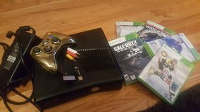 Xbox 360 Slim bundled with games in Naperville, Illinois