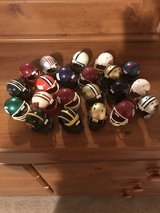 21 mini football helmets in Fort Riley, Kansas