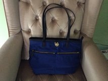 Michael kors tote/purse , lots of pockets.( gently used) in Glendale Heights, Illinois