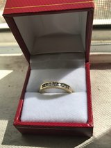 14 K solid heavy gold diamond wedding band in channel set 1/2 carat total weight diamonds. in San Diego, California