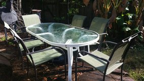 patio table and chairs in Spring, Texas
