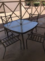 wrought iron patio set with glass table in Luke AFB, Arizona
