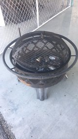 fire pit with adjustable grill in 29 Palms, California