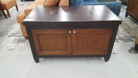 Black and brown tv stand in Camp Lejeune, North Carolina