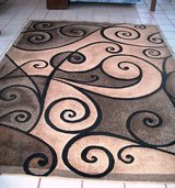 2  E-large Brown Matching Carpets. in Alamogordo, New Mexico