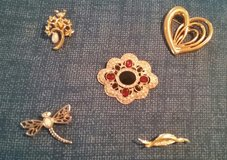 Set of 5 gold tone pins in Beaufort, South Carolina