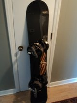 Volkl Snowboard wih Custom Burton Bindings and travel case. in Camp Lejeune, North Carolina