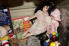 Porcelain doll with chair in Tomball, Texas