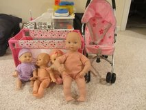 Toy baby stroller, toy pack and play, 4 dolls in Batavia, Illinois