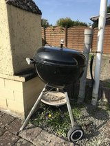 Charcoal grill with grilling utensils in Ramstein, Germany